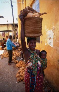 mother carrying baby basket, mombasa, kenya