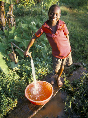 boy at water tap, chuka village, mount kenya