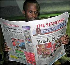 man reading the standard newspaper, kenya