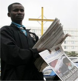 kenya street newspaper seller
