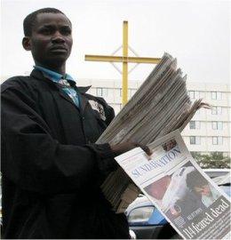kenya street newspaper seller