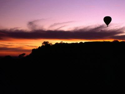 hot air balloon at sunset, masai mara, kenya