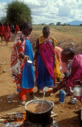 Masai women cooking for a wedding feast, Amboseli, Kenya