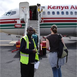 passengers entering their kenya airways flight at nairobi airport