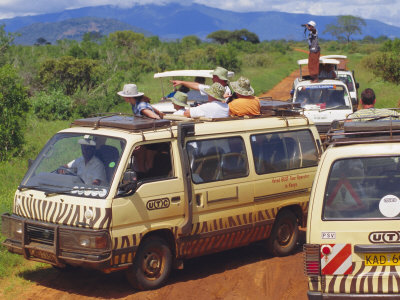 safari vehicles, tsavo national park, kenya
