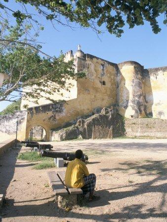 man in front of fort jesus, mombasa, kenya
