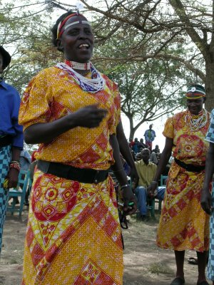 kuria woman singing and dancing, kenya