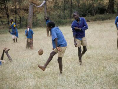 school children playing football or soccer, west kenya