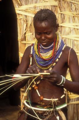 turkana woman weaving, lake turkana, kenya